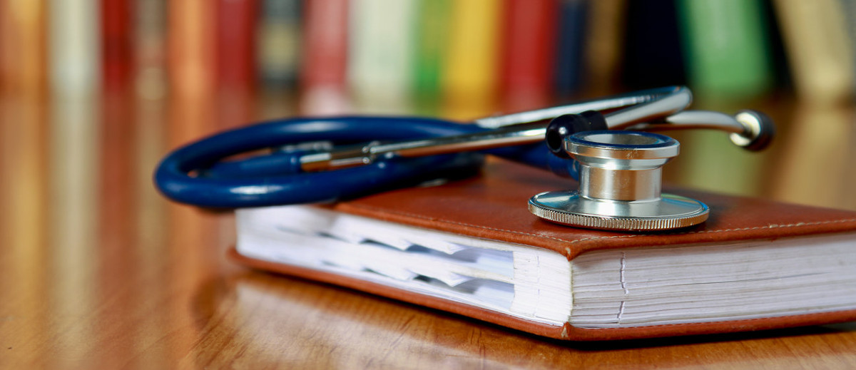 stethoscope resting on a book
